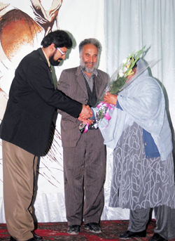 rawa presents flowers to taj mohammad ahmadzada and sadique two brave afghans